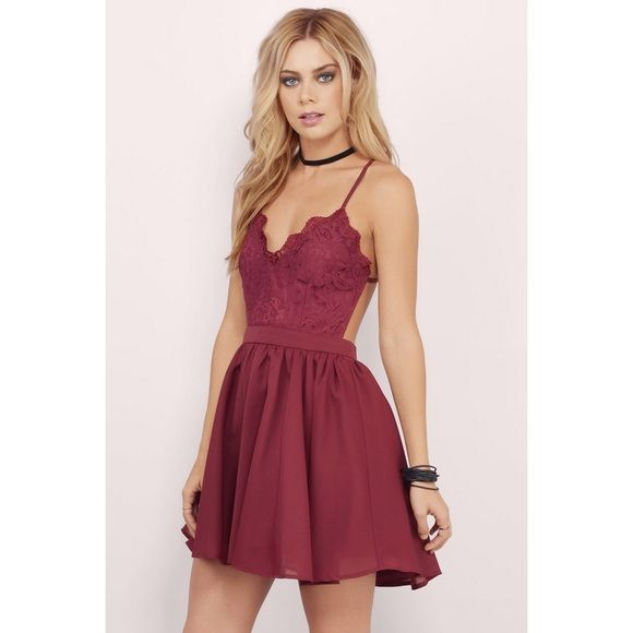 NEW Sexy Tobi Dress Brand new with no tags. Purchased for a formal, but decided to wear a brighter colored dress. Size medium, skater skirt styled. Maroon with a lace top and super strappy back. Very sexy and sophisticated. Great for formals, homecoming or a night out! Offers welcome. Tobi Dresses Mini
