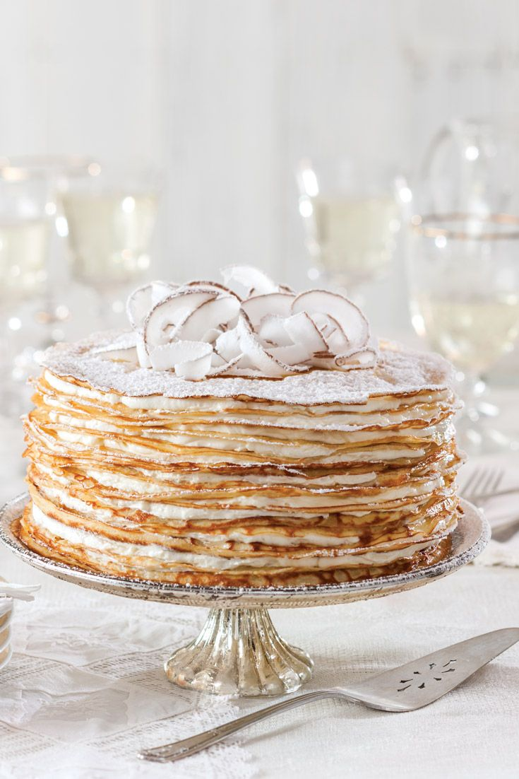 Crêpe Cake with Coconut Filling: Two dozen paper-thin French pancakes form our towering Crêpe Cake with Coconut Filling.  - victoriamag.com