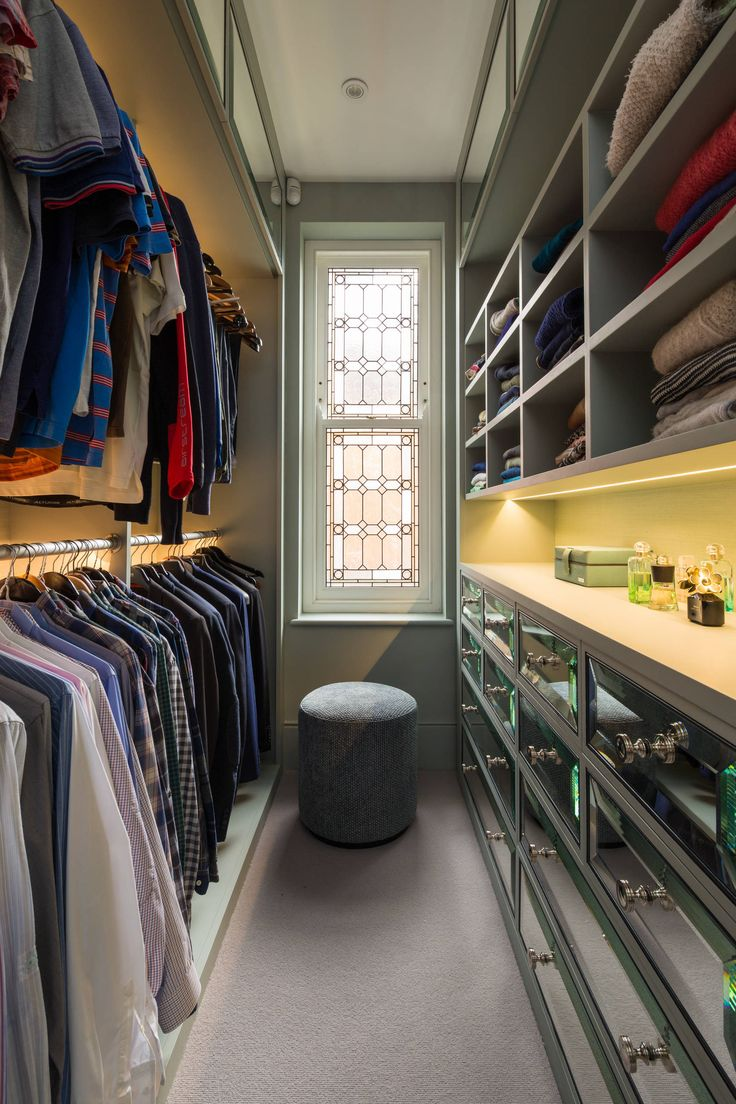 i like the lights, the open shelf area & the mirrored drawers.