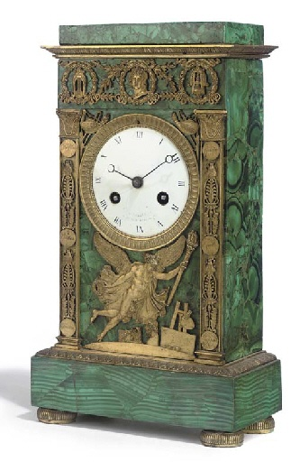 AN EMPIRE MALACHITE AND ORMOLU MANTEL CLOCK  EARLY 19TH CENTURY  The dial inscribed 'L.MALLET/H.DE M D D'ORLEANS', the twin barrel movement with countwheel strike on bell  14½in. (36.8cm.) high; 8in. (20.3cm.) wide