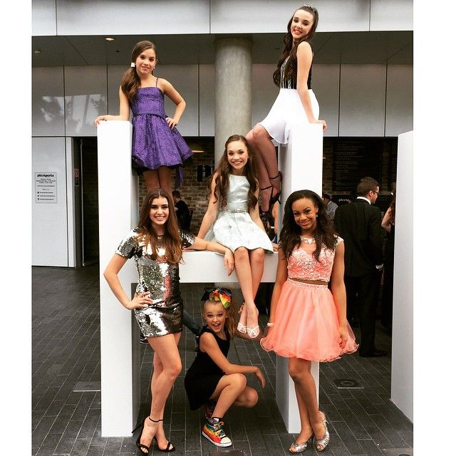 Dance Moms Girls Posing at the Astra Awards. Top left to right; Mackenzie Ziegler, Kendall Vertes, Kalani Hilihiker, Jojo Siwa, Maddie Zeigler and Nia Frazier