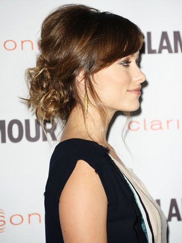 Olivia Wilde, low messy bun and teased roots for extra volume. Really