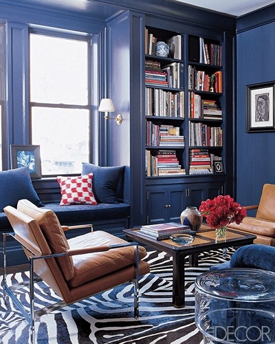 For some reason i've always pictured building a navy blue library/office like this one.