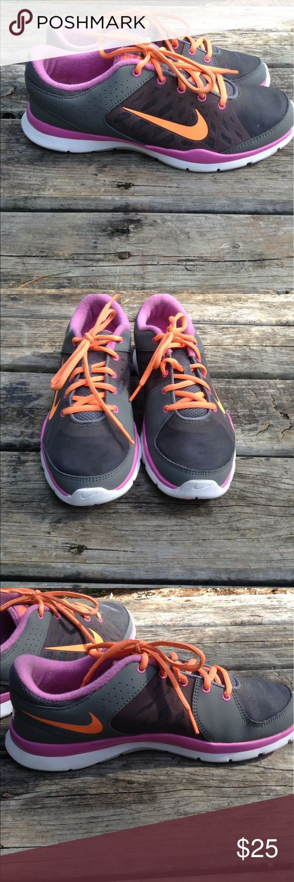 💖Women's Nike Flex Trainer 3💖 Shoe are in good preowned condition with minor stuffs.Has one small hole on side of one shoe see:pictures. Breathable mesh and foam upper,padded collar/tongue,lightweight.Size:9.5 Color:Grey,Orange,Pink .Overall good lightweight shoes Nike Shoes Athletic Shoes