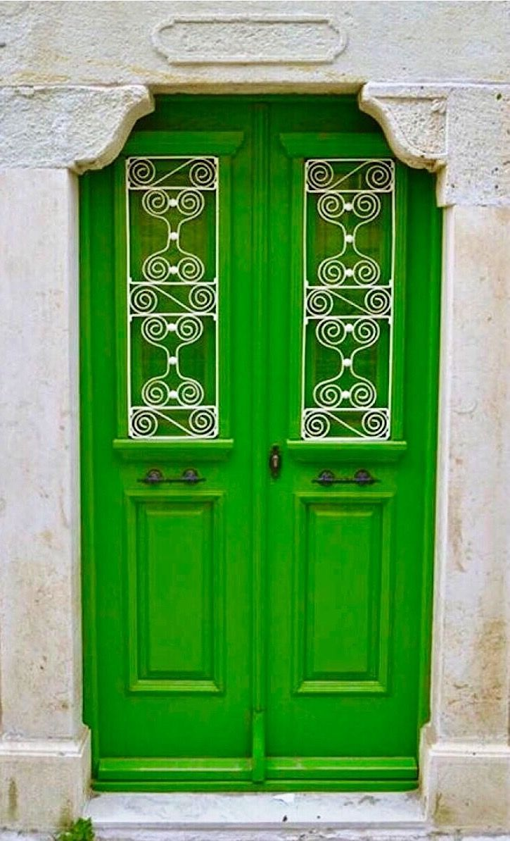 Simple design and detail on this green door in Greece