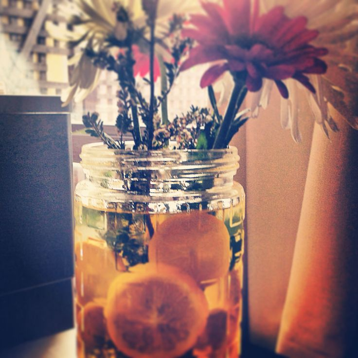 Lemon slices with flowers in a jar
