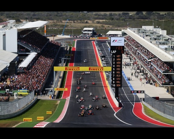 AUSTIN, TX - NOVEMBER 18:  Sebastian Vettel of Germany and Red Bull Racing leads the field up the hill towards the first corner at the start of the United States Formula One Grand Prix at the Circuit of the Americas on November 18, 2012 in Austin, Texas.