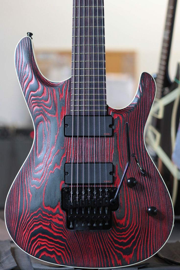 Mayone - Setius PRO 7 Gothic with red graining Ash top matt finish, Mahogany back, 5-ply Mahogany/Maple bolt-on neck, Rosewood fingerboard, Set of EMG 707TW active pickups, Original Floyd Rose 7-string bridge, Schaller tuners, Black hardware