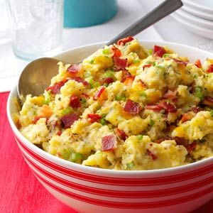 Loaded Smashed Taters Recipe -I can make an entire pot of smashed taters in the time it takes to bake a single potato. I like to use baby Yukon Golds because the skins are very thin and easy to mash. Make this to your taste—sometimes I add in garlic and chives or sub shallots for the green onions. My husband loves these potatoes with a steak, and even my 20-month-old daughter enjoys them! —Andrea Quiroz, Chicago, Illinois