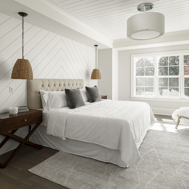 Bedroom with diagnonal shiplap accent wall and v g…