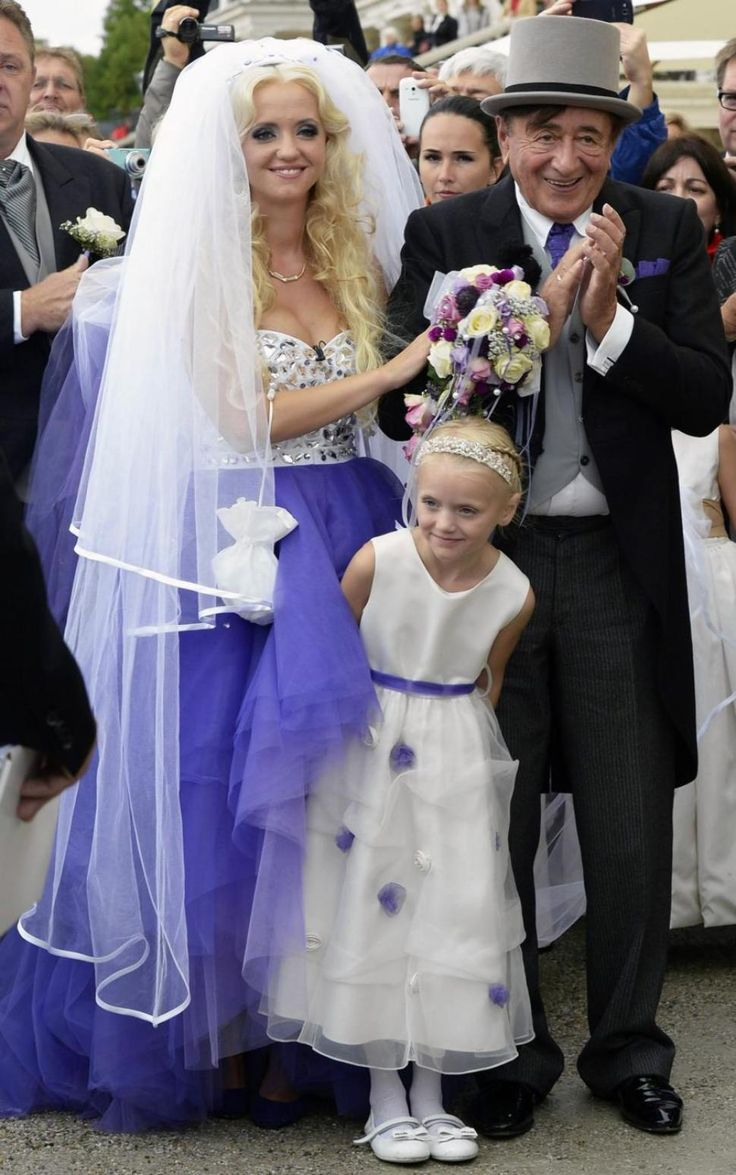 Austrian entrepreneur Richard Lugner (r.) and Cathy Schmitz get married. He's 81 and she's 24. Ok...Cute bouquet though.