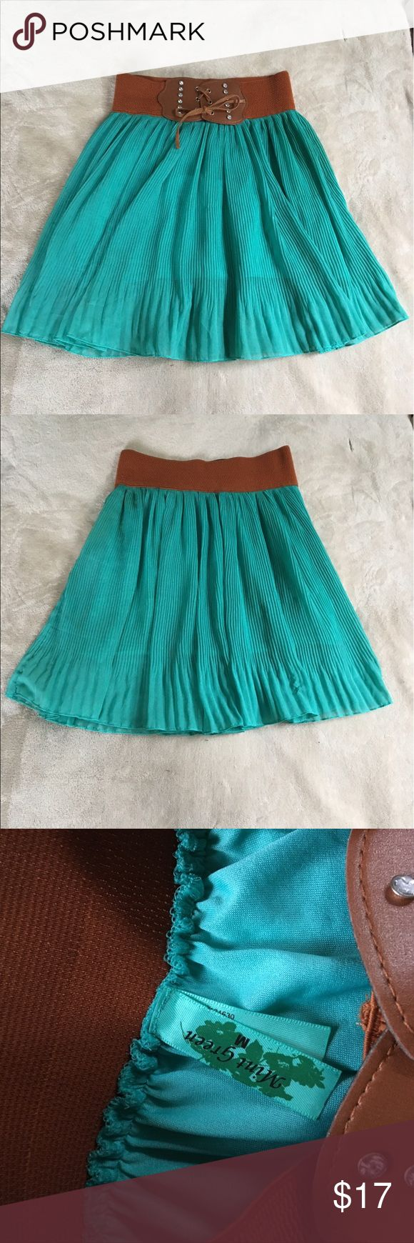 Mint Green Sheer Skirt Mint Green brand size medium skirt with brown elastic waist band ties in front to look like a belt slip underneath is shorter than the overlay. Waist is 24 inches(not stretched) length of underneath is 14 inches length of overlay is 18 inches. 100% polyester. In excellent condition. mint green Skirts Midi
