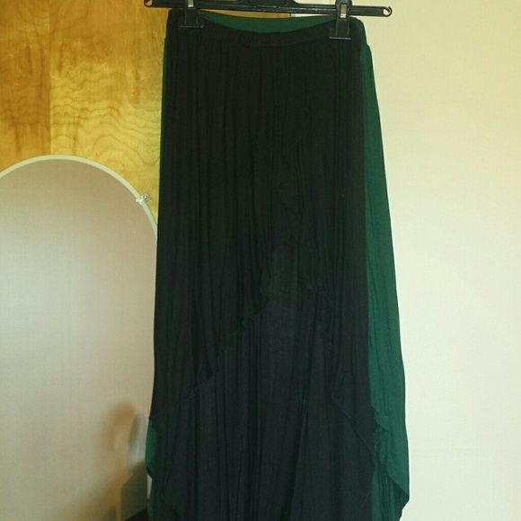 Brandy melville long skirts The black one is authentic Brandy Melville cotton long skirt, very soft. On the front it is short and long on the back. The green one is Setai Milano brand, both come from Italy, both very soft cotton and so girly! Very good conditions! ONE SIZE FITS ALL Brandy Melville Skirts Asymmetrical