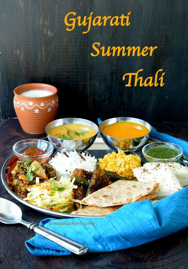 Gujarati Summer Thali includes traditional food recipes along with fresh mango pulp (aamras), which is an integral part of the meal during summer season.