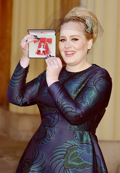 Adele's Royal Honor Adele held up her MBE award during an investiture ceremony with Prince Charles at Buckingham Palace in London Dec. 19.   Read more: http://www.usmagazine.com/hot-pics/adele-s-royal-honor-20131912#ixzz2ooTmDoVp  Follow us: @Us Weekly on Twitter   usweekly on Facebook