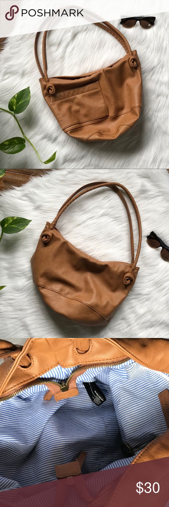 ✨✨URBAN OUTFITTERS Tan Faux Leather Shoulder Bag Lightly Used Tan Purse with Cloth Lining. Erin Templeton Purse Purchased From Urban Outfitters. Zipper Closure. Slightly signs of Use In Interior Lining Urban Outfitters Bags Shoulder Bags
