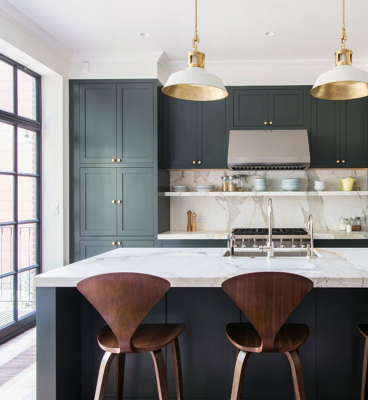 Black cabinets, marble counter, brass hardware