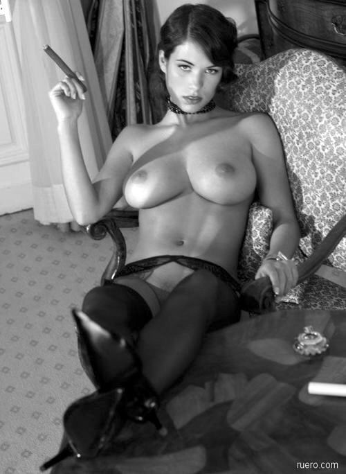 Artistic Photo Of A Topless Model Smoking A Cigar