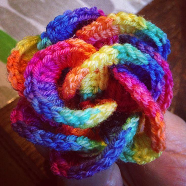 Crochet rainbow hand dyed sock yarn. Crochet chain links wound to a rose