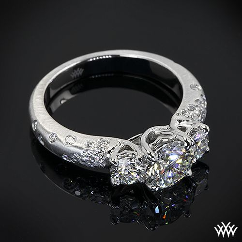 Custom 3 Stone Champagne Engagement Ring is set in platinum and holds 0.80ctw in A CUT ABOVE® Hearts and Arrows Diamond Melee. The 4 prong center head holds a beautiful 0.865ct A CUT ABOVE® Diamond.