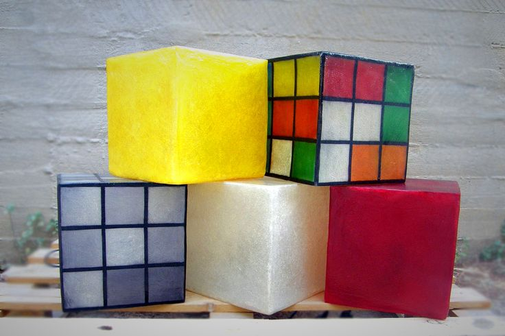 Lighting fixture in the shape of a cube, made out of fiberglass. It can be hung from the ceiling as the central lighting fixture of any space, or be put on any surface (table, shelf, floor) as a lamp standing on it own.  The cubes can be easily moved around. They come complete with an E14 bulb holder and you can use as much wattage as you need.