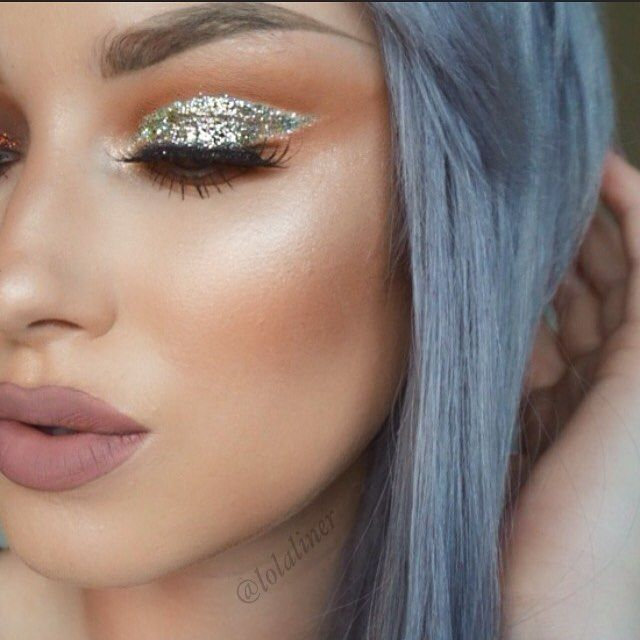 Love the way she applied the silver glitter with the rosy crease shadow and a rose/nude lip