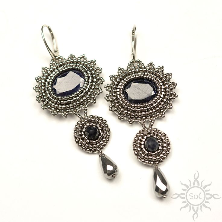 #beading #beadwork #beadembroidery #naturalsapphire #facetedsapphire #sapphire #beadedcabochon #sapphirejewelry #elegantjewelry #gemstoneearrings #sapphireearrings #artisanearrings #semipreciousjewelry #embroideredearrings #silverearrings #statementearrings #silversapphire #bluesilver