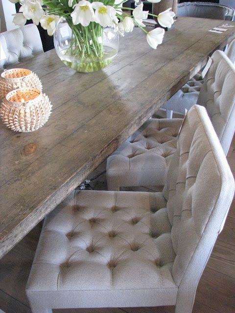 Reclaimed harvest table and linen tufted side chairs