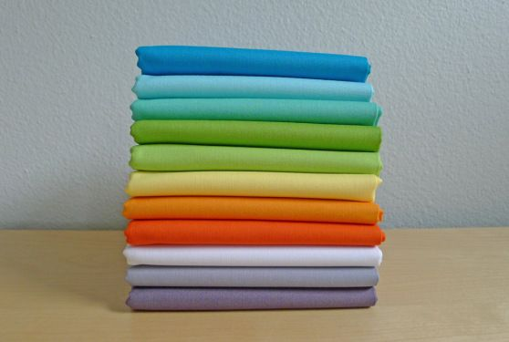 MQG logo colors in Kona solids: Cyan, Azure, Candy Green, Lime, Chartreuse, Buttercup, School Bus, Tangerine, White, Medium Grey and Coal.