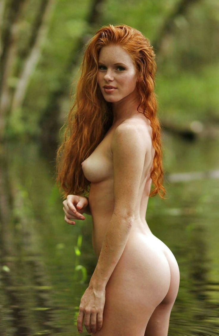 beautiful naked girl redhead by water