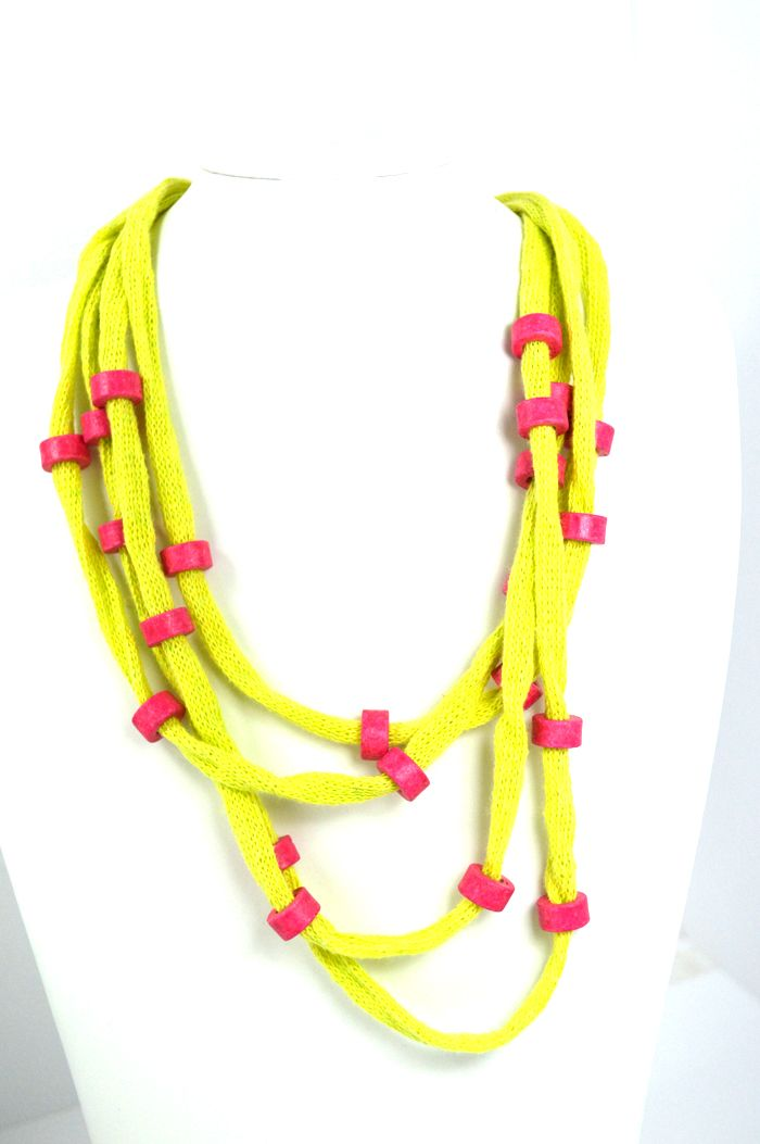 Green lime cotton cord embellished with pink handmade ceramic beads and wire. Detail: the metal clasp with crystalls. Total length approx. 55 cm. Comes in a gift box.