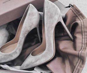 Grey suede pumps.