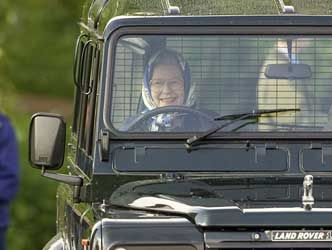 I love that QE still drives herself in a classic Land Rover Defender.