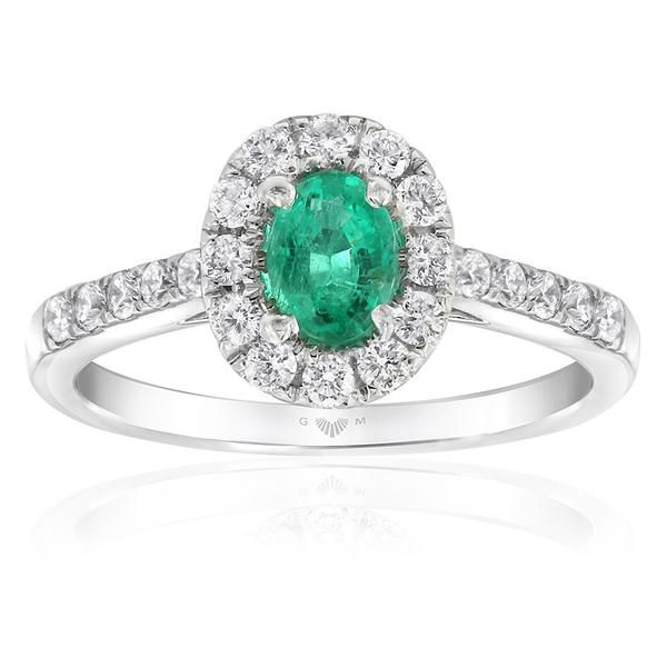 The luminescent Aura ring design by Gerard McCabe. Featuring a bright green, natural emerald surrounded by brilliant white diamonds. Crafted in 18ct white gold. Allow 6 weeks to custom make this ring for your finger size. The Aura ring is specially designed to wear stacked with the Aura Linea diamond band which sits flush alongside this ring. Emeralds are soft gemstones and must be worn with care.