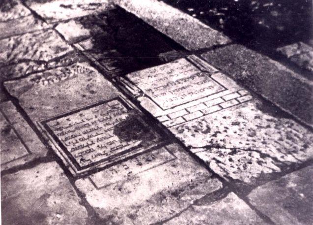 ~This is terrible.  Jewish gravestones used for paving, Radom, Poland