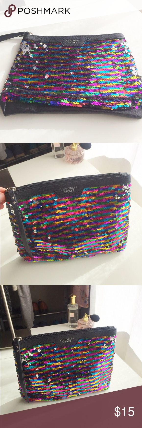 Victoria's Secret sequin clutch In excellent condition, barely used. Gorgeous multi coloured sequins which are silver coloured on the reverse side Victoria's Secret Bags Clutches & Wristlets