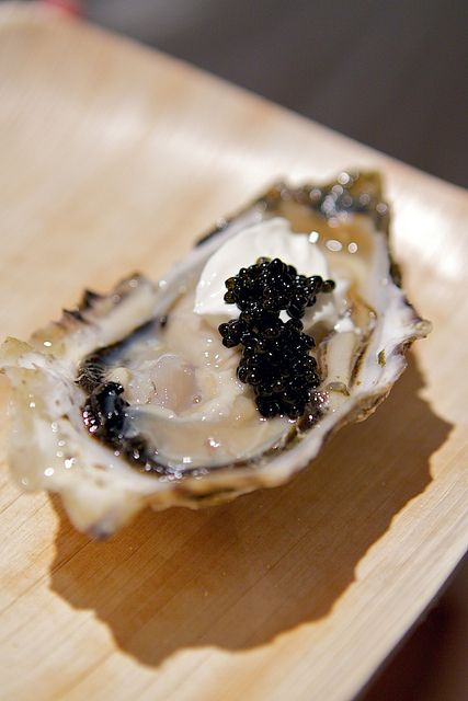 Oyster with caviar and crème fraiche... Pure Decadence!