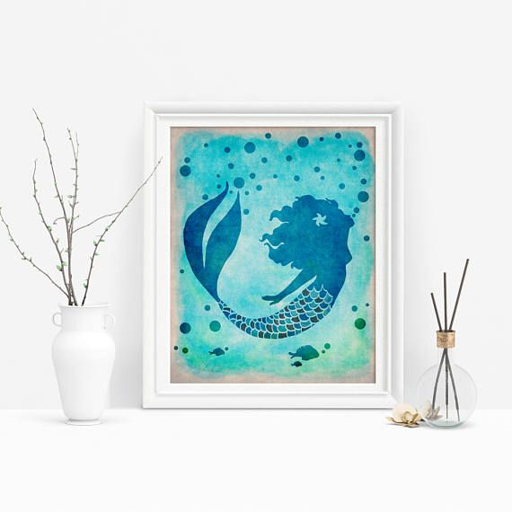 This printable mermaid is a lovely touch for any beach decor! Just download, print, and hang #mermaidart #underthesea #mermaidtail