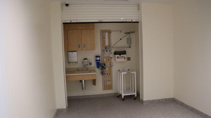 Behavioral health pulldown garage door open garage