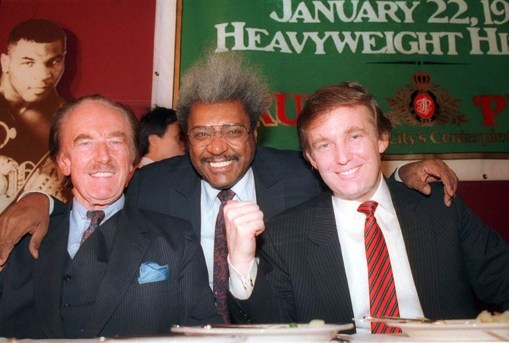 Donald Trump, right, with his father, Fred, left, and boxing promoter Don King participate in a news conference in Atlantic City, N.J., in December 1987. Many of President-elect Donald Trump's cultural touchstones, which he'd frequently namedrop at campaign rallies and on Twitter, including Don King, were at their peak in the 1980s. (Associated Press Archives)