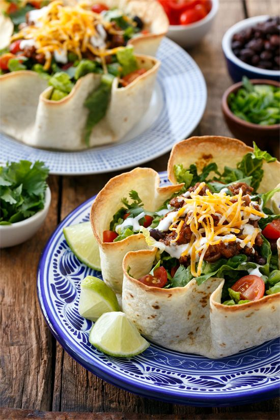 Saucy and Flavorful Beef Taco Salad, plus how to make your own (Baked!) Homemade Tortilla Bowls. A surprisingly quick and flavorful dinner your whole family will love!