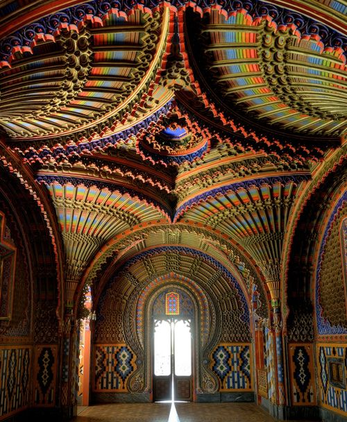 """The Peacock Room at Castello di Sammezzano in Reggello, Tuscany, Italy.  Atop a hill in a Tuscan oak tree grove, you'll find the abandoned Sammezzano Castle. The derelict building, built in 1605 with funds from Spanish nobility, features intricate Moorish designs and a breathtaking assortment of patterns and colors. Inside, the words """"Non Plus Ultra"""" — meaning """"nothing further beyond"""" in Latin — stands out above an archway."""
