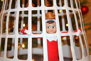 """Elf on the Shelf in """"jail"""" for taking Sheriff Woody's cowboy hat"""