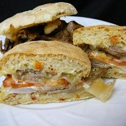 ultimate steak sandwich with tender and juicy steak and sauteed onions ...