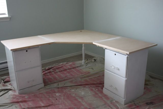 Corner desk made using a simple corner table top and two filing cabinets — beingBrook.  I'd like ours to be longer on each side.