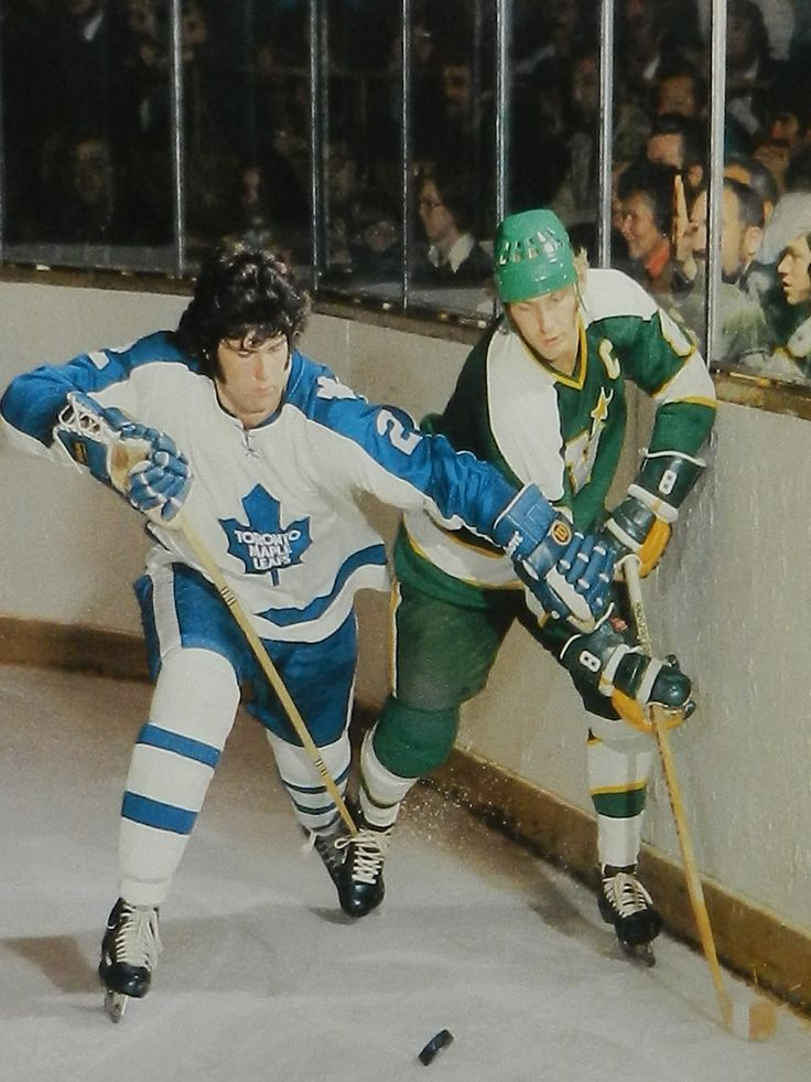 ROOKIE LEAFS DEFENSEMAN IAN TURNBULL RIDES BILL GOLDSWORTHY OF MINNESOTA NORTH STARS INTO END-BOARDS AT THE GARDENS ON OCT. 23, 1973. (Photo: Howard Berger)