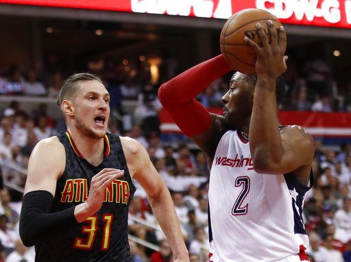 WASHINGTON (AP)(STL.News) — John Wall scored a playoff career-high 32 points and Markieff Morris added 21 in his NBA playoff debut as the Washington Wizards beat the Atlanta Hawks 114-107 Sunday in Game 1 of their first-round series.    Wall scored...