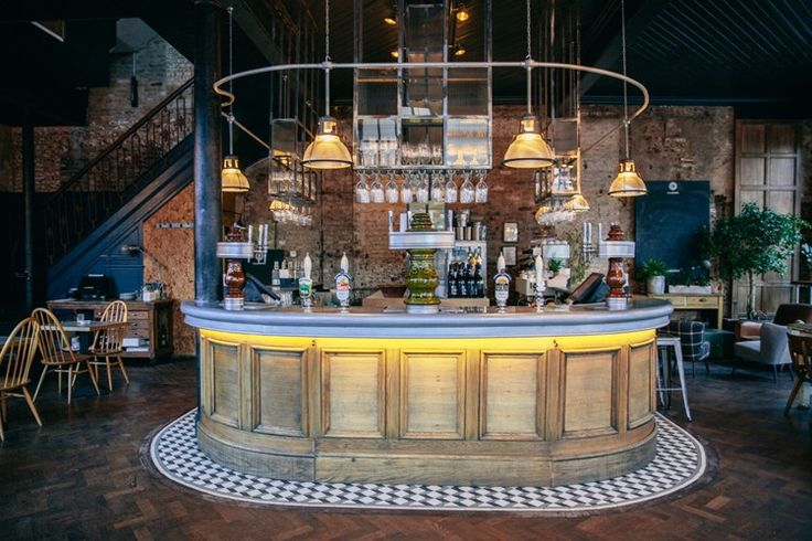 The industrial decor of The Culpeper is illuminated with striking pendant lights and rustic furniture