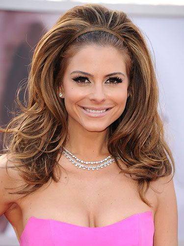 """fun & girly style can be achieved w/thick or thin hair,it's easier for those w/fuller locks.To get actress's look,curl hair from roots to ends w/a 2""""curling iron.Pin up the top half of hair,tease up the section underneath the crown,then smooth the pinned portion back over the teased area.Finally,take a few strands from the base of the neck, pull them up over the front like a headband, & secure w/bobby pins. Those with thinner hair should preempt styling w/  volumizing shampoo & conditioner."""