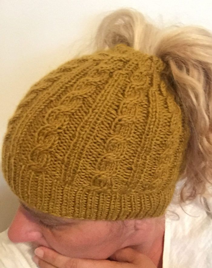 Free Knitting Pattern for Cabled Messy Bun Hat - Sizes Child b3256570fbb